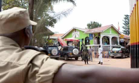 Ugandan police secure the site of the Ethiopian Village restaurant in Kampala