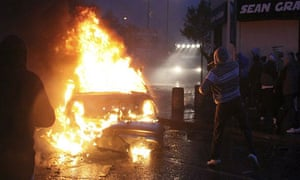 Irish nationalist rioters burn a hijacked car in the Ardoyne area of north Belfast last night