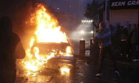 Irish nationalist rioters burn a hijacked car in the Ardoyne area of north Belfast last night