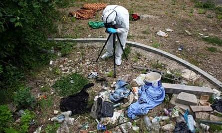 A police officer photographs a crime scene