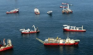 Oil sheen is seen among vessels assisting near the source of the BP oil spill in the Gulf of Mexico