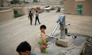 A girl at a communal water pump in Kabul, Afghanistan