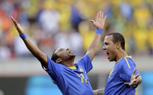 Netherlands v Brazil: Robinho celebrates with team mate Fabiano after scoring against Netherlands