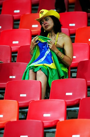 Netherlands versus Brazil: Dejected Brazil fan sits in the stands