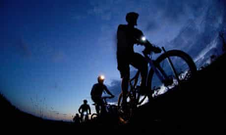 Mountain biking at night with lights Mabie Forest Scotland UK. Image shot 2006. Exact date unknown.