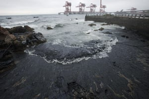 Dalian oil fire in China: Oil washes ashore at Dalian's Port in Liaoning province