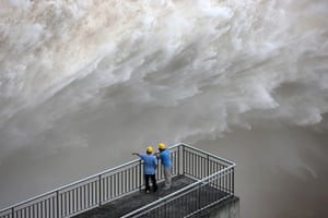 Three gorges dam: The Three Gorges Dam discharges water to lower the level in a reservoir