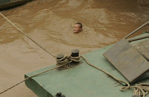 China floods: A boy swims in the flooded Yangtze river in Chongqing