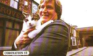 Coronation Street actor William Roache holds Frisky the cat