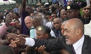 Suriname president Desi Bouterse greets supporters