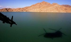 Shadow of a Chinook on Kajaki dam, Helmand, where Taliban shot down a Chinook, killing seven troops