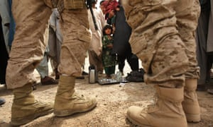A US marine and his translator meet Afghan villagers