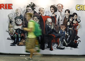Comic Con: An attendee walks past a poster at the Comic Con convention in San Diego