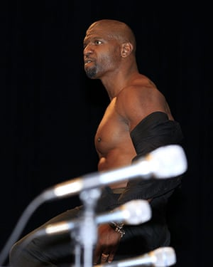 Comic Con: Terry Crews shows off his physique at a conference for 'The Expendables'