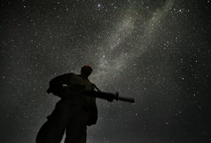 Afghanistan: 26 August 2009: A US Marine keeps watch at night in the base in Khan Neshin