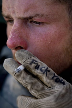 Afghanistan: 11 April 2007: A soldier takes a smoke break near Sangin, Helmand province