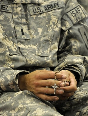 Afghanistan: 12 April 2009: A US soldier from 1st Infantry Division holds a rosary