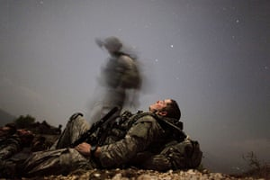 Afghanistan: 12 August 2009: A US soldier takes a break