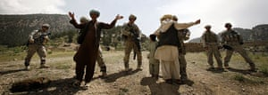 Afghanistan: 7 May 2008: Afghan men are searched before attending a shura