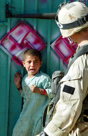 Afghanistan: 19 May 2003: A girl cries in fear