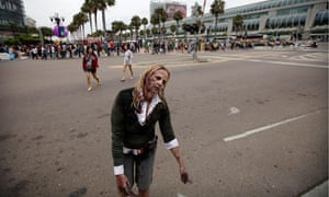 A woman dressed as a zombie to promote the The Walking Dead outside the convention centre