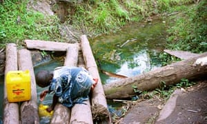 A child collects water in Uganda