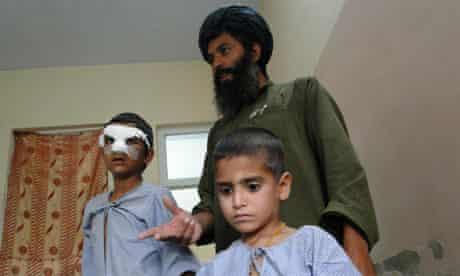 Afghan Haji Abdul Ghafar with his son Agha Shereen