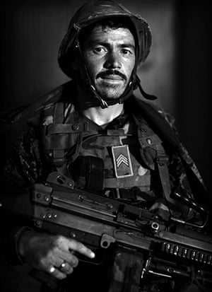 Afghan National soldiers: Afghan National Army soldier Sgt. Din Mohammed, an ethnic Tajik