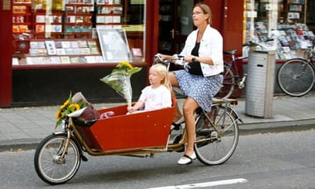 woman riding a bicycle with her daughter Amsterdam Holland. Image shot 08/2007. Exact date unknown.