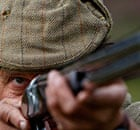 A shooter watches a grouse