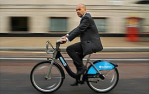 London cycle hire: A member of the public rides a hired bicycle