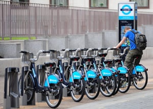 London cycle hire: A man sits on a bicycle at a London Transport Cycle Hire bay