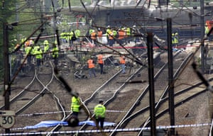 Potters Bar train crash: Emergency workers on the tracks after a train derailed at Potters Bar