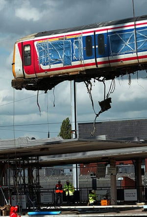 Potters Bar train crash: The wrecked train carriage is removed by crane