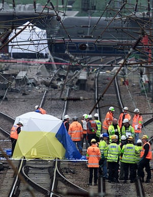 Potters Bar train crash: Transport police examine an area of track near the Potters Bar rail crash