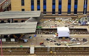 Potters Bar train crash: The fourth carriage of a derailed train at Potters Bar station
