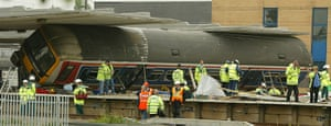 Potters Bar train crash: A carriage of the train involved in the crash on its side at the station