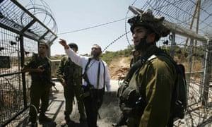 An armed Jewish settler from Karmi Tsor
