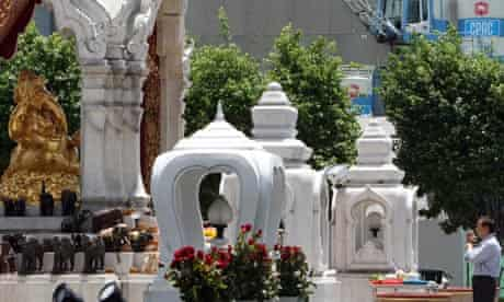 Thai man worships at shrine in Bangkok