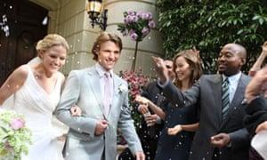 confetti throwing outside wedding