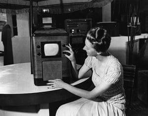 Television: 1938: A woman demonstrating a television set at a Radio Exhibition