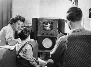Television: 1950: A family watching television at home
