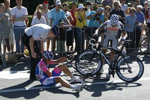 TDF Crashes: Italy's Mirco Lorenzetto receives as