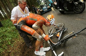 TDF Crashes: Juan Jose Oroz gingerly picks up his bike after coming off i