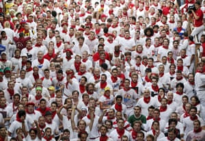 San Fermín fiesta: Hundreds of 'mozos,' or runners, walk through the streets of Pamplona