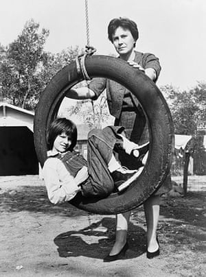 To Kill a Mockingbird: Harper Lee holding tire swing with child actress, Mary Badham