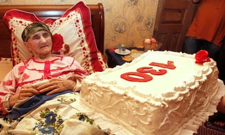 Antisa Khvichava rests during her 130th birthday party in the village of Sachino in Georgia