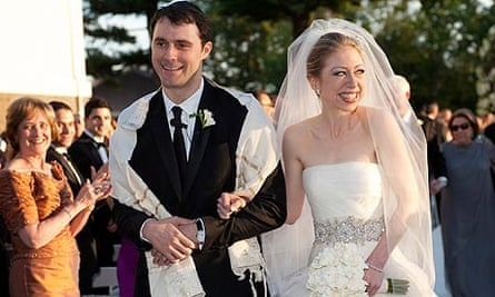Chelsea Clinton walks with Marc Mezvinsky after their wedding ceremony at Astor Court in Rhinebeck