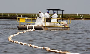 Workers continue to collect leaked oil off the coast of Louisiana