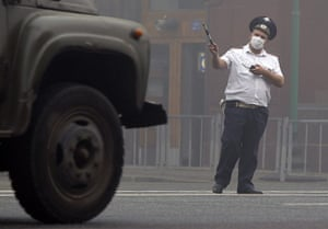 Moscow smog: A traffic controller from the Interior Ministry wears a protective mask